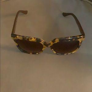 """""""O"""" by Oscar de la Renta sunglasses."""